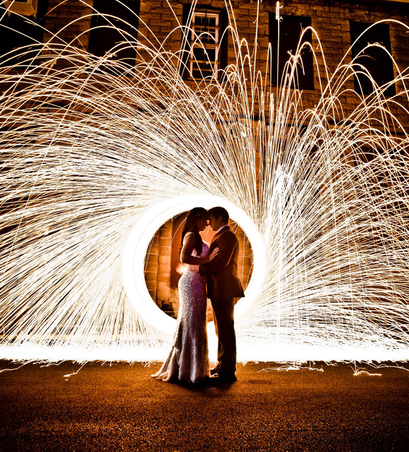 Bride and Groom outside in front of sparklers