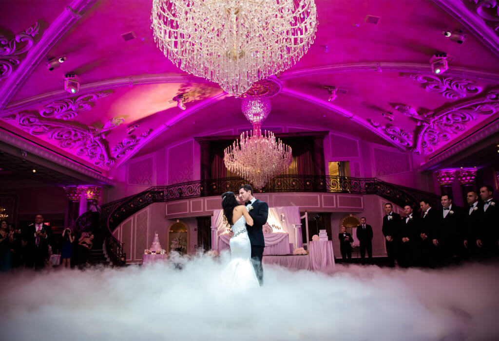bride and groom dancing on clouds