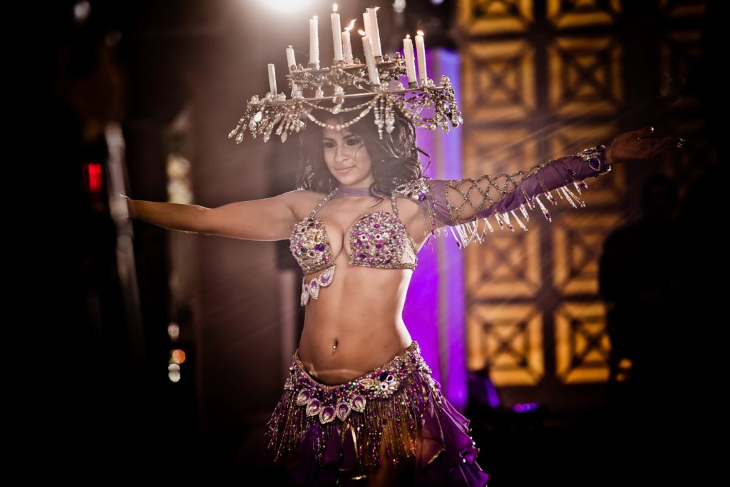 belly dancer with candles on her head